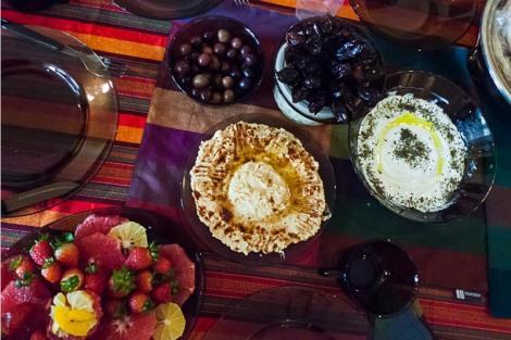 Hummus, labneh (yogurt and garlic dip), olives, and fresh dates.